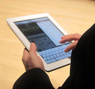 Joe Menn uses an iPad 2